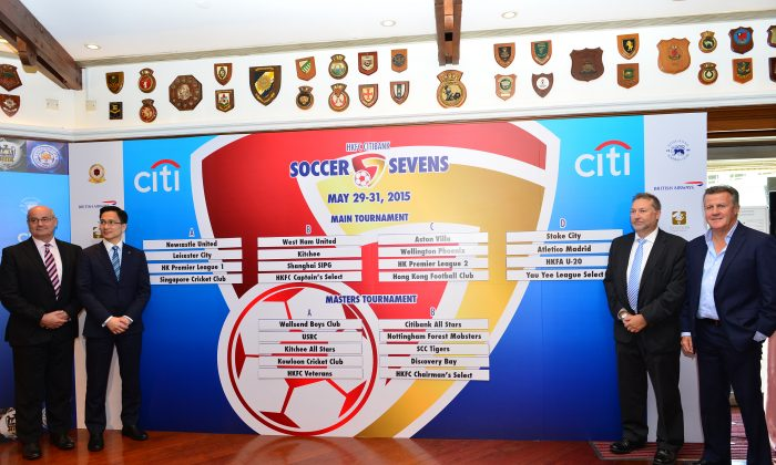 Results of the draw for the 16th HKFC Citibank Soccer Sevens at the Hong Kong Football Club on Tuesday April 14, 2015 flanked by top table representatives. (L to R) Mark Sutcliffe, Chief Executive HKFA; Wayne Fong, Head of Corporate Affairs, Citi Hong Kong; Chris Plowman, Tournament Director HKFC Soccer Sevens Organising Committee; and Tony Brasanos, Chairman HKFC Soccer Sevens Organising Committee. (Bill Cox/Epoch Times)
