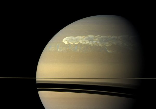 This huge storm churning through the atmosphere in Saturn's northern hemisphere overtakes itself as it encircles the planet in this true-color view from NASA's Cassini spacecraft. (NASA/JPL-Caltech/SSI)