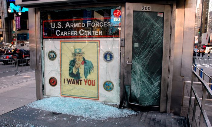 Shattered glass is spread all over the entrance to the U.S. Armed Forces Career Center after a bomb was placed by a person riding a bike at Times Square, New York, on March 8, 2008. (U.S. Marine Corps/Cpl. Karim Delgado)