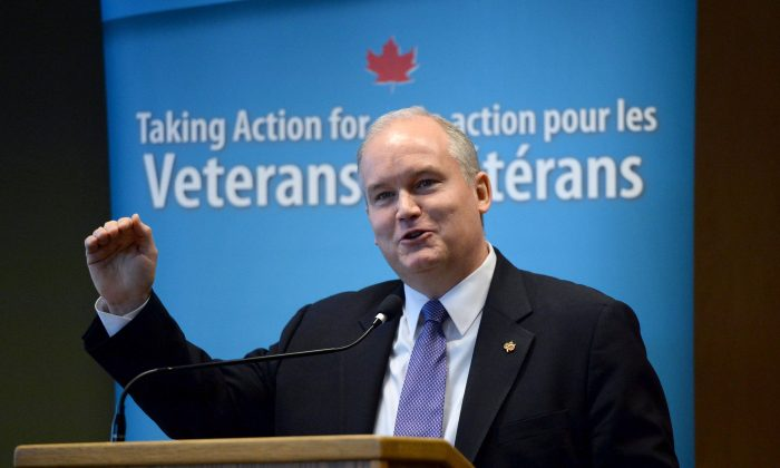 Veterans Affairs Minister Erin O'Toole speaks during a Veterans Affairs stakeholder summit in Ottawa on April 14, 2015. The widespread criticism of the New Veterans Charter isn't justified, despite the fact it has been amended multiple times, O'Toole said this week. (The Canadian Press/Sean Kilpatrick)
