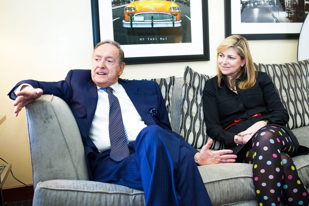 Bill Fisher, founder of the Fischer Travel Enterprises, and his daughter Stacy Fischer-Rosenthal in the company's office in Midtown Manhattan, New York, on April 10, 2015. (Petr Svab/Epoch TImes)