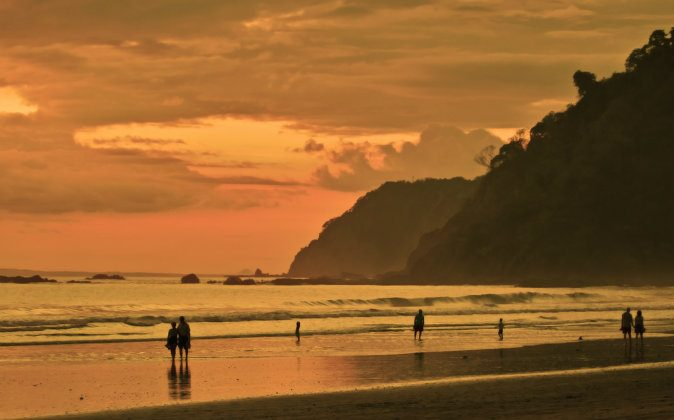 Jaco beach at sunset via Shutterstock*