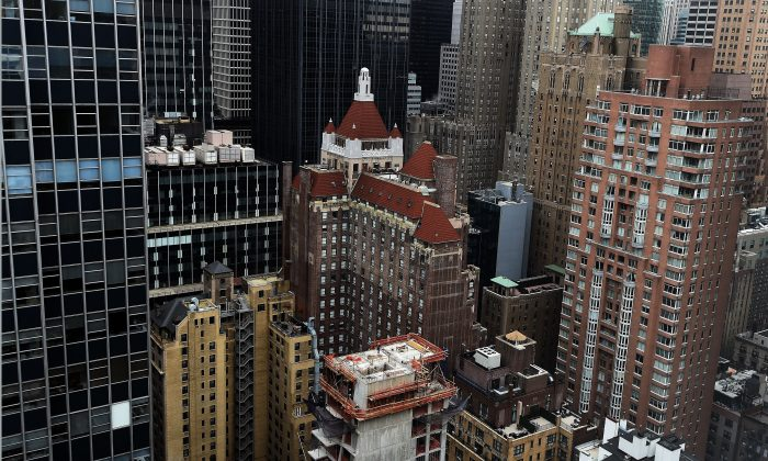 A highrise APARTMENT building under construction in New York on March 31, 2105. (Jewel Samad/AFP/Getty Images)
