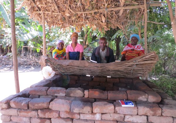 Members of a women's group in Nduruma, Tanzania, stand over their zero-energy cool chamber, or ZECC. ZECCs can extend the life of fresh produce by a few days up to two weeks. Credit: Rachel Cernansky.