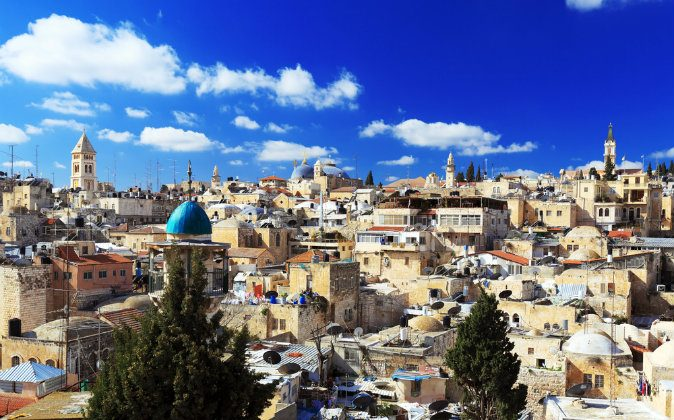 Roofs of Old City with Holy Sepulcher Chirch Dome, Jerusalem, Israel via Shutterstock*