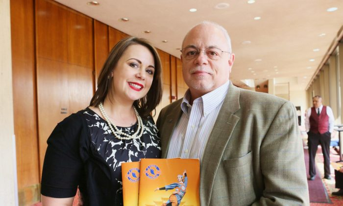 Danielle Lowe (L) and her father attend Shen Yun Performing Arts at Norfolk's Chrysler Hall, on April 11, 2015. (Lisa Fan/Epoch Times)