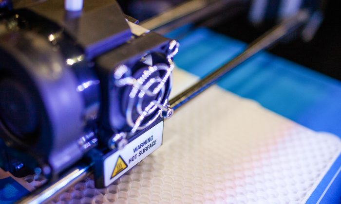 A 3D printer in action at the Inside 3D Printing Conference and Expo 2015 in the Javits Convention Center, Manhattan, New York, on April 16, 2015. (Petr Svab/Epoch Times)