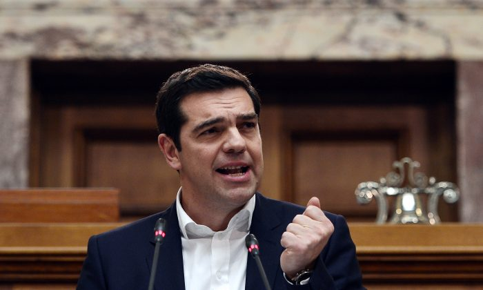 Greece's Prime Minister Alexis Tsipras addresses MP's at the Greek Parliament in Athens on Feb. 5. Tsipras tried but failed in an April 8 visit to Moscow to get Russia to provide loans that would help Greece out of its economic crisis. (LOUISA GOULIAMAKI/AFP/Getty Images)