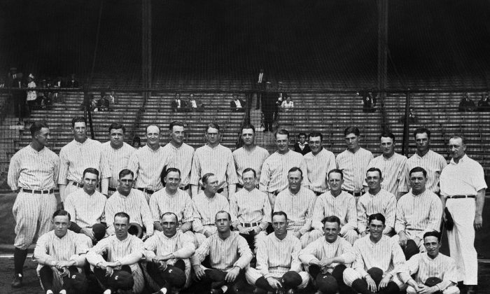 "The 1927 New York Yankees, often mentioned in the same breath with ""one of the best teams of all time."" Lou Gehrig and Babe Ruth are, respectively, first and third from left in the back row. Manager Miller Huggins is at center, middle row. The batting order, better known as Murderers' Row, led nearly every offensive category in the league. The team finished at 110-44 (.714), 19 games ahead of the second-place Philadelphia Athletics. (AP Photo)"