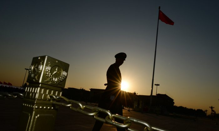 A Chinese para-military officer patrols Tiananmen Square in Beijing on November 12, 2013. Chinese cyberspies recently tried breaching the computer of NSA historian Michael Aid. (MARK RALSTON/AFP/Getty Images)