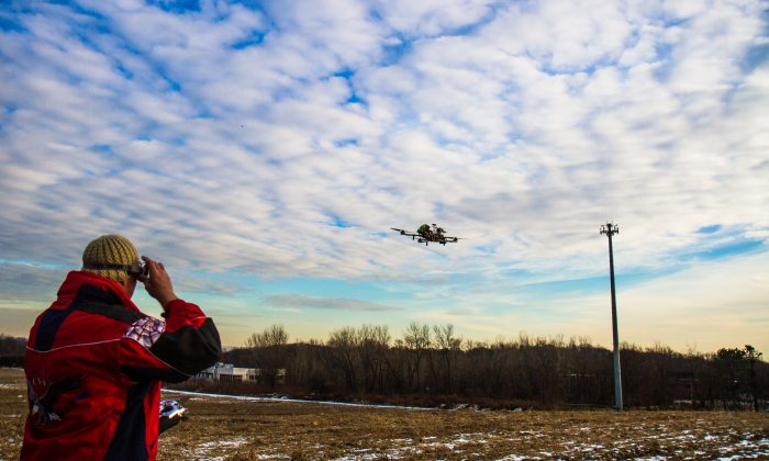 Charles Whiting, a helicopter pilot, flies his drone in Montvale, New Jersey on January 11, 2015. (Amelia Pang/Epoch Times)