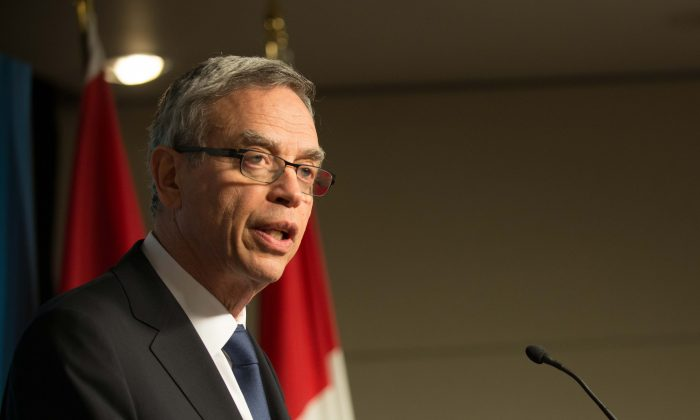 Finance Minister Joe Oliver said his balanced budget lays the groundwork for economic stability during a press conference in Ottawa Tuesday, April 21, 2015. (Matthew Little/Epoch Times)