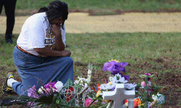 Marie Fogle Hamilton prays as she visits a memorial set up on the site where Walter Scott was killed on April 11 in North Charleston, S.C. Chad Posick argues the practice of empathy could help prevent incidents such as the Walter Scott shooting. (Joe Raedle/Getty Images)