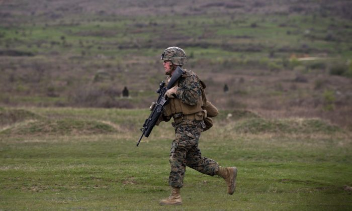 A U.S. Marine trains with the North Atlantic Treaty Organization (NATO) ally Bulgaria on April 14, at the Novo Selo military ground. Several Balkan states are now pushing for NATO membership. (NIKOLAY DOYCHINOV/AFP/Getty Images)