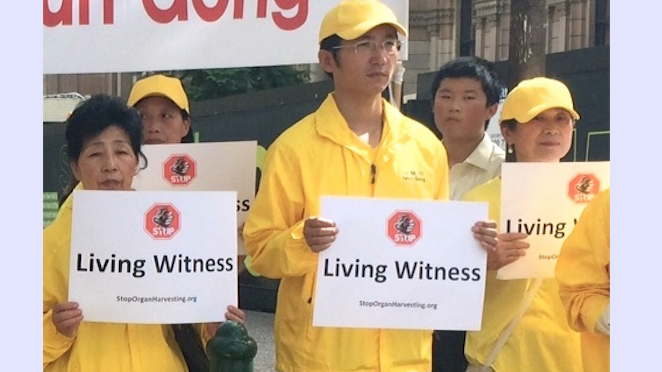 Former Masters student, Jintao Liu (C) at a rally in Sydney, April 16. Beaten and tortured in a Chinese labour camp for practising Falun Gong, he recalls a police officer yelling out to the prison thugs beating him not to damage his organs. (Shar Adams/Epoch Times)