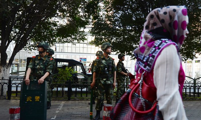 Chinese paramilitary police stand guard in the Muslim Uighur minority area of Urumqi, Xinjiang Province on June 30, 2013. (Mark Ralston/AFP/Getty Images)