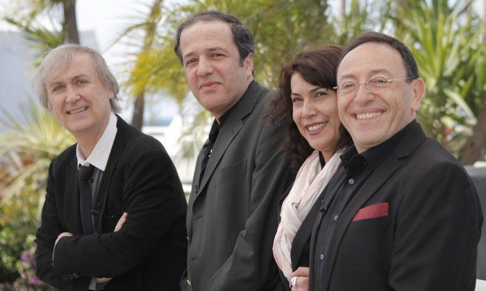 (L-R), cartoonists Plantu, Dilem, Willis From Tunis and Kichka support Cartooning For Peace at the 66th international film festival, in Cannes, France, on May 20, 2013. (AP Photo/Francois Mori)