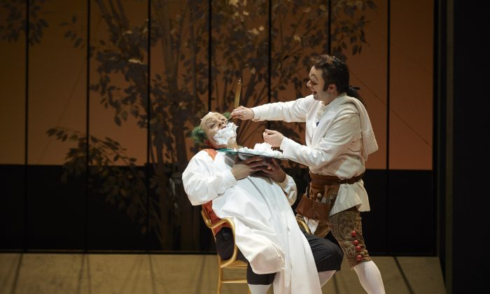 "Renato Girolami as Doctor Bartolo and Joshua Hopkins as Figaro in the Canadian Opera Company production of ""The Barber of Seville."" (Michael Cooper)"