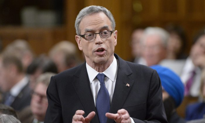 Finance minister Joe Oliver answers a question after delivering the federal budget speech in the House of Common on Parliament Hill in Ottawa on April 21, 2015. (The Canadian Press/Adrian Wyld)