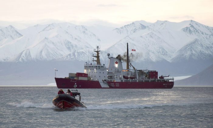The CGS Des Groseilliers, an icebreaker in the Canadian Coast Guard, sits in Pond Inlet, Nunavut, on Aug. 23, 2014. As Canada prepares to hand off leadership of the Arctic Council to the United States this weekend, a new survey suggests security fears are growing among people in Arctic countries. (The Canadian Press/Adrian Wyld)