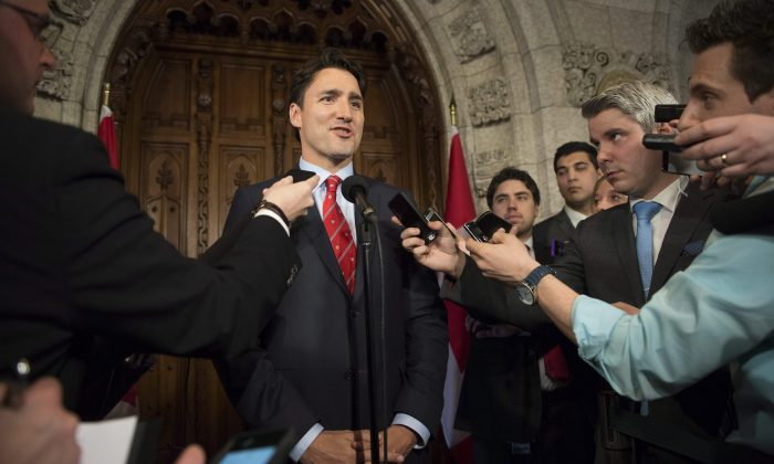 Liberal Leader Justin Trudeau talks to reporters about the federal budget in the foyer of the House of Common on April 21, 2015. Insiders say Trudeau intends to soon unveil at least one major economic plank from the Liberals' eventual election platform. (The Canadian Press/Justin Tan)