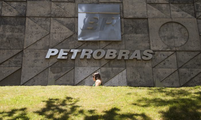 People walk past Petrobras building in Rio de Janeiro, Brazil on December 12, 2014. (Vanderlei Almeida/AFP/Getty Images)