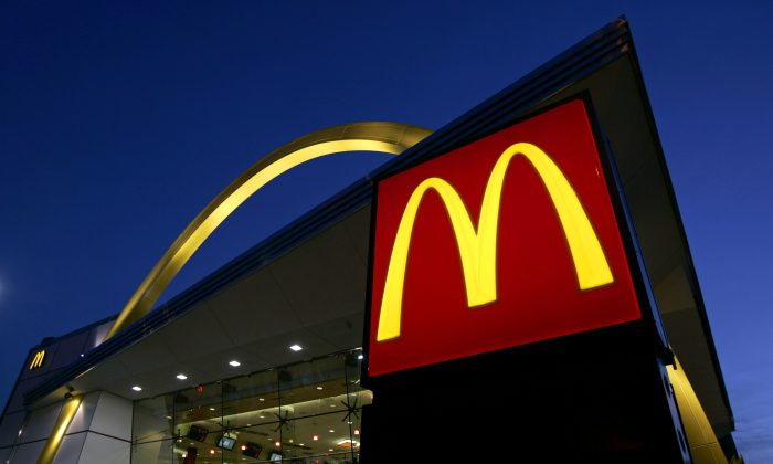 FILE-In this April 20, 2006 file photo, a McDonald's restaurant logo and golden arch is lit on Chicago's near North Side. (AP Photo/Jeff Roberson)