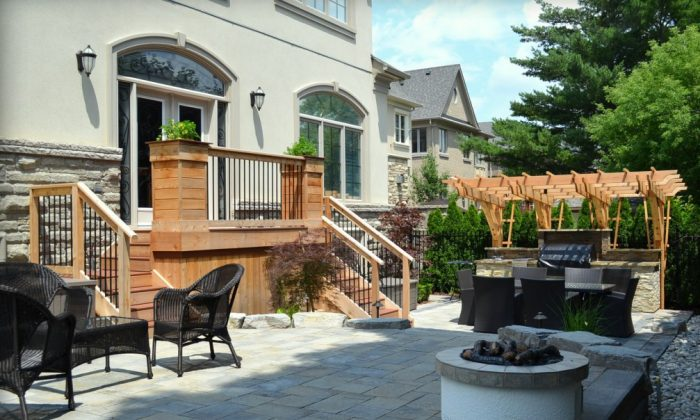 The easiest way to have a low-maintenance backyard is to put a stone patio from fence to fence. (eieihome.com)