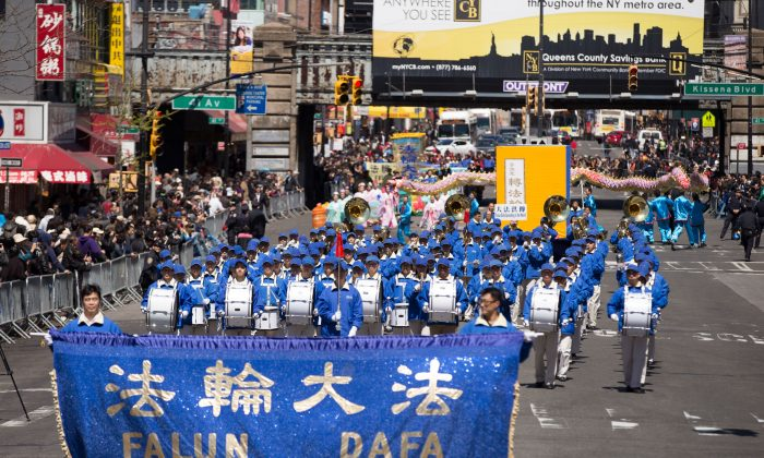 2,000 people march in a parade in Flushing, New York, on April 25, 2015, calling for an end to the persecution of Falun Gong in China and celebrating 200 million people who have quit the Chinese Communist Party since 2004. (Edward Dye/Epoch Times)