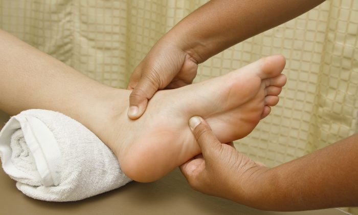 Reflexology involves applying alternating pressure with the hands to specific points on the feet, hands, ears, or face that can affect various organs and parts of the body. (praisaeng/iStock/Thinkstock)