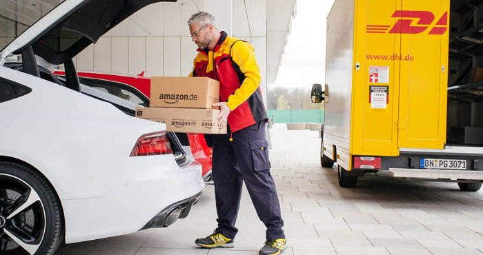 An Amazon courier demonstrates the trunk-locker delivery concept (Amazon).