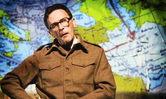 "Matthew Zajac in the one-man play, ""The Tailor of Inverness,"" uses projected maps to trace possible routes his father took in WWII. (Tim Morozzo)"