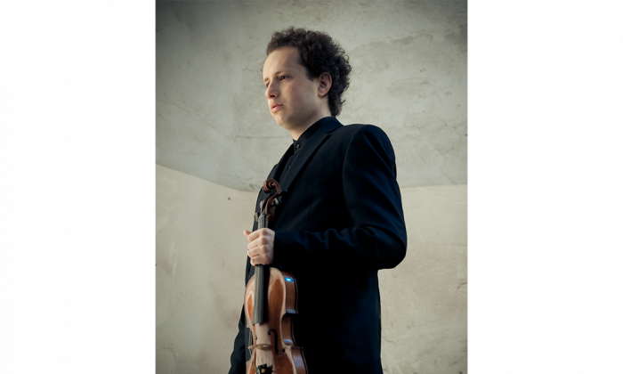 """Yuval Herz with his Jean-Baptiste Vuillaume violin, on loan from the America-Israel Cultural Foundation. The Israeli violiinist will perform as guest concertmaster and violinist for the Ottawa Symphony Orchestra's performance of Verdi's """"Requiem"""" on April 27, 2015. (Ilan Spira)"""