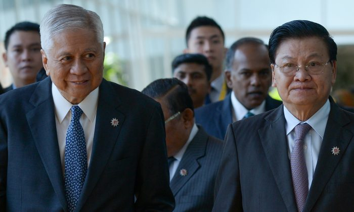 Philippines's Foreign Affairs Minister Albert del Rosario (L) and Laos' Foreign Minister Thongloun Sisoulith arrive for the ASEAN Foreign Ministers Meeting (AMM) in Kuala Lumpur on April 26. ASEAN members are expected to call for a code of conduct on the South China Sea. (MOHD RASFAN/AFP/Getty Images)
