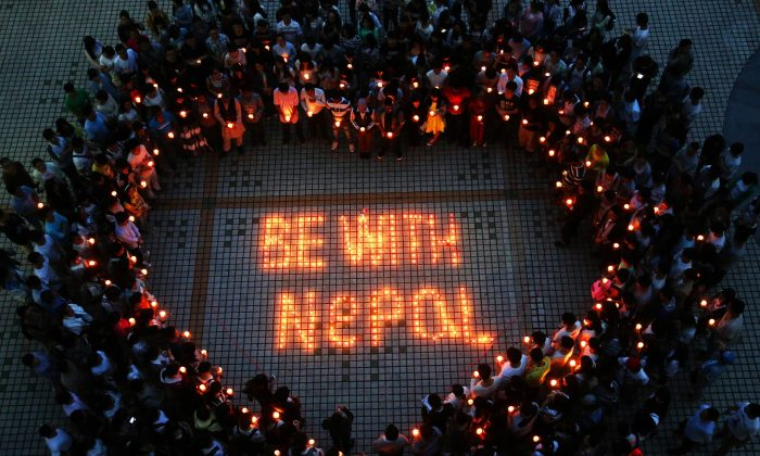 Nepalese students and Chinese students gathering to pray for Nepal in Nanhua University in Hengyang, central China's Hunan province on April 26, 2015. (STR/AFP/Getty Images)
