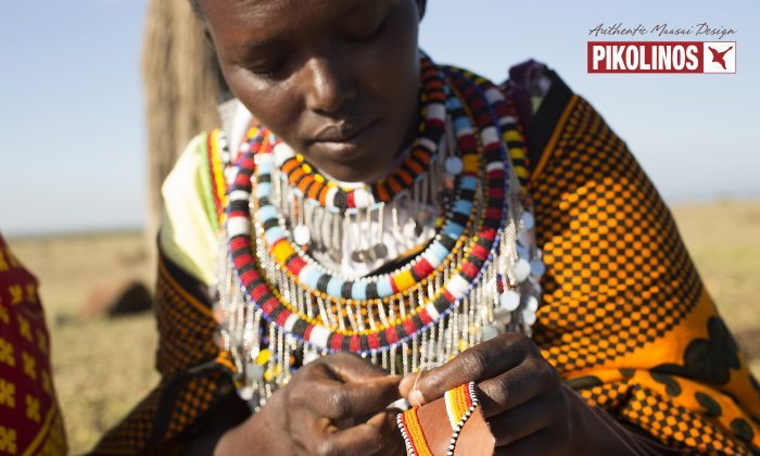 A publicity image from Pikolinos showing a Maasai woman embroidering a piece of leather with beads. (Courtesy of Pikolinos)