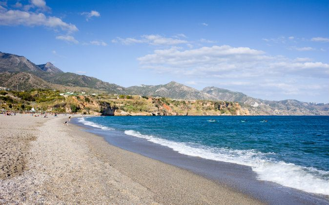 Burriana beach in Nerja, Malaga via Shutterstock*