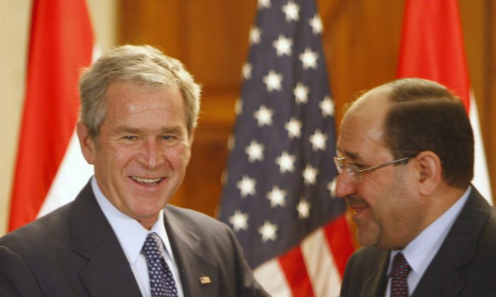 Iraqi Prime Minister Nuri al-Maliki shakes hands with U.S. President George W. Bush (L) during a joint press conference in Baghdad on Dec. 14, 2008. (Thaier Al-Sudani/AFP/Getty Images)