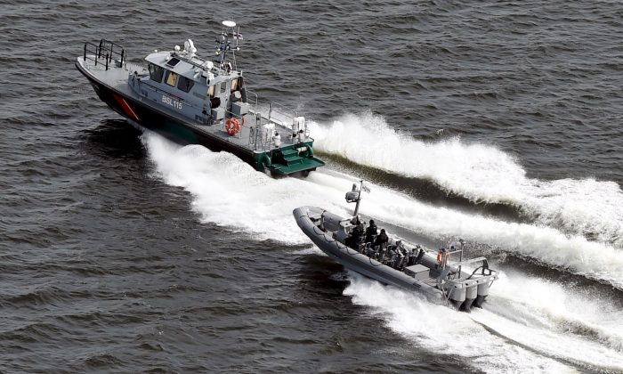 Boats of the Finnish Border Guard patrol the waters outside Helsinki Tuesday, April 28, 2015. (Jussi Nukari/LEHTIKUVA via AP)