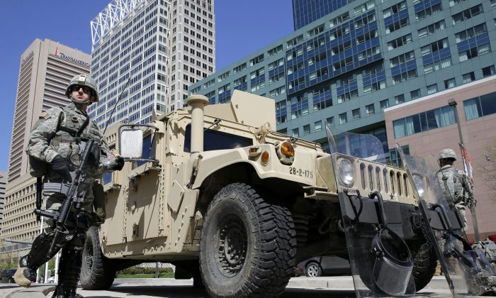 Maryland National Guardsmen patrol near downtown businesses in Baltimore, on Tuesday. (AP Photo/Patrick Semansky)