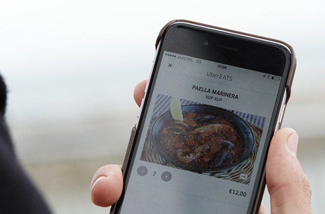A UberEats user ordering food delivery from the existing Uber app. (Source Uber)