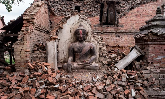 Saturday just before noon, tourists posted photos of Nepal's World Heritage sites. Moments later, swath of a deadly fault system below the city. (David Ramos/Getty Images)