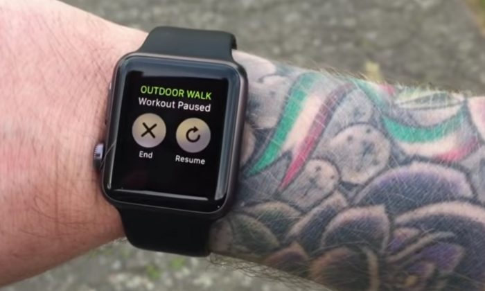 A screenshot of a video posted to YouTube by Michael Lovell showing how he has to frequently re-enter his password when wearing his Apple Watch on his tattooed arm.