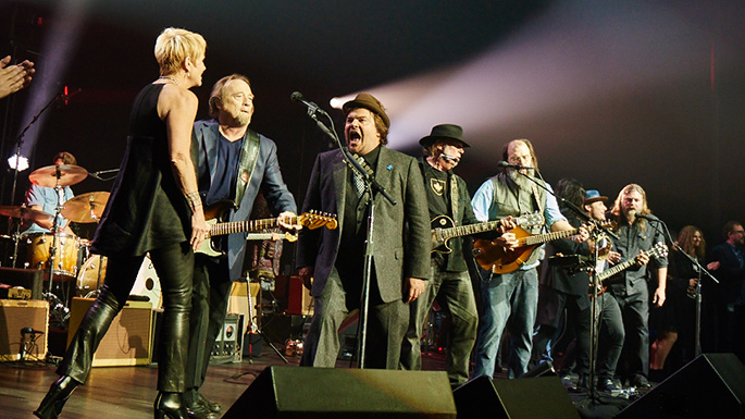"(L-R) Shawn Colvin, Stephen Stills, Jack Black, Neil Young, Steve Earle and others sing ""Rocking in the Free World"" at Light Up the Blues autism benefit concert at the Pantages Theater, Hollywood, Calif. (Autism Speaks)"