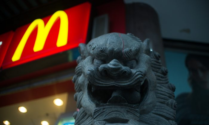 A lion statue is pictured next to a McDonald's fast food restaurant in Shanghai on July 28, 2014. (Johannes Eisele/AFP/Getty Images)