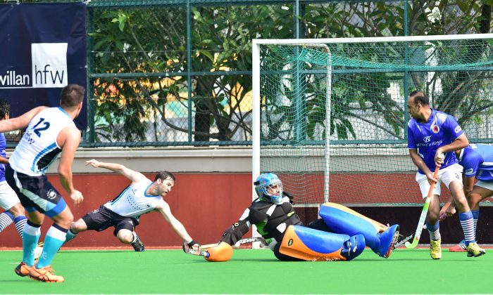 Punjab-A goalie makes a great save during their Holland Cup Semi-final match against HKFC-A at Hong Kong Football Club on Sunday April 26. Punjab-A won the game 8-5 to move into the final against SSSC-A on May 10, 2015. (Bill Cox/Epoch Times)