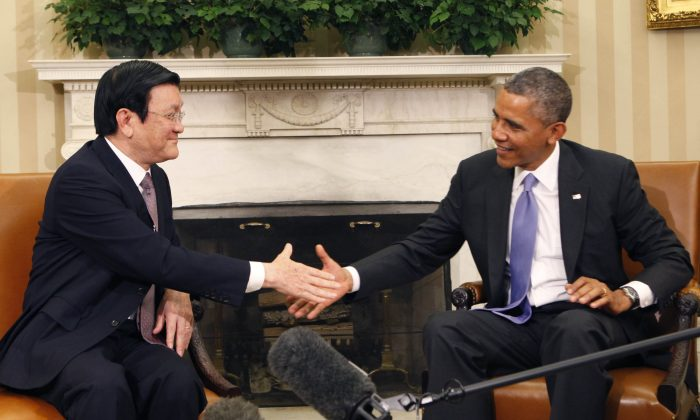 President Barack Obama meets with President Truong Tan Sang of Vietnam in the Oval Office in Washington on July 25, 2013. (Dennis Brack-Pool/Getty Images)