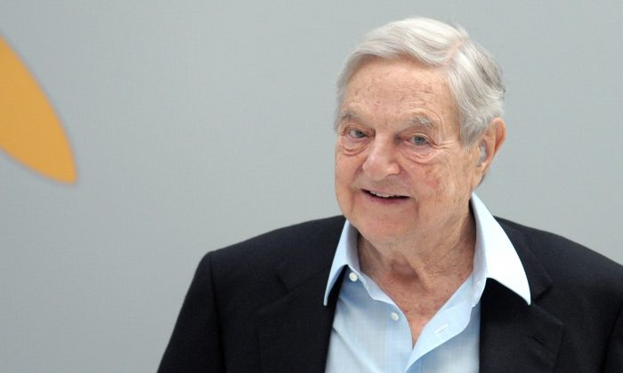 ungarian-born US chairman of the Soros Fund Management, George Soros, arrives to attend a session of the 6th annual conference of the Institute for new economic thinking (INET) at the OECD headquarters in Paris on April 9, 2015. AFP PHOTO / ERIC PIERMONT (Photo credit should read ERIC PIERMONT/AFP/Getty Images)