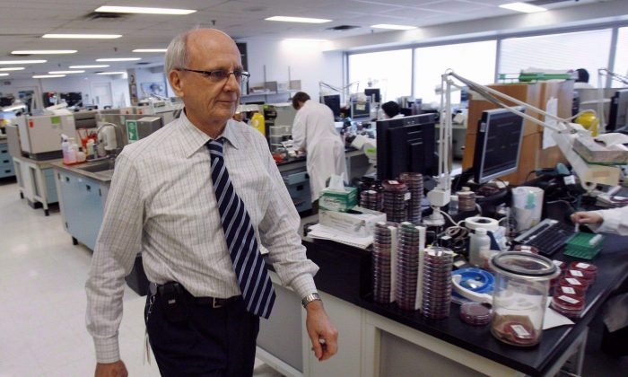 Dr. Donald Low walks through the laboratory in Toronto's Mount Sinai hospital, Feb. 19, 2008. With more than half of Canada's lab technicians coming up for retirement within the next 10 years, politicians are being warned of a looming shortage. (The Canadian Press/J.P. Moczulski)