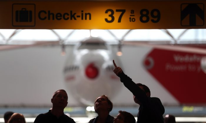Passengers check flight information boards during the first day of a 10-day strike by TAP pilots at the Portela international airport, Friday, May 1, 2015, in Lisbon, Portugal. Pilots at Portugal's state-owned national airline have begun a 10-day strike, forcing flight cancellations as they press their demand to be given